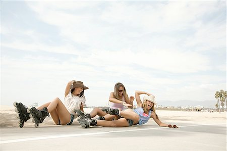 roller skate - Three young women, wearing inline skates, on floor after falling over Stock Photo - Premium Royalty-Free, Code: 614-08201914
