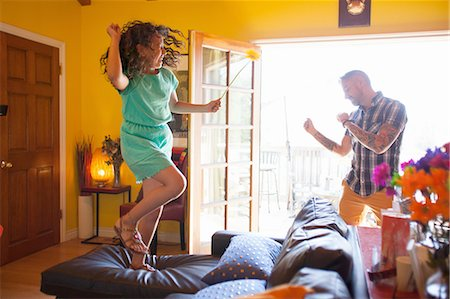 preteen dancing - Girl and father dancing in living room Stock Photo - Premium Royalty-Free, Code: 614-08202010