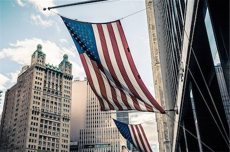 View of buildings and American flags, Manhattan, New York, USA Stock Photo - Premium Royalty-Free, Code: 614-08202365