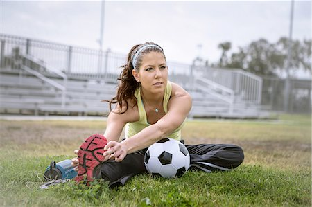 footballeur - Soccer player stretching in field Stock Photo - Premium Royalty-Free, Code: 614-08219894
