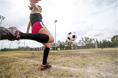 Soccer player practising in field Stock Photo - Premium Royalty-Free, Code: 614-08219890
