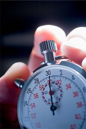 stop watch - Cropped shot of hand holding silver stop watch Stock Photo - Premium Royalty-Free, Code: 614-08219913