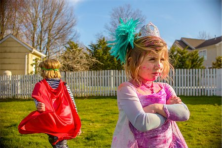 superhero costume - Children in costumes sulking after fight Stock Photo - Premium Royalty-Free, Code: 614-08270167