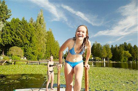 Girls in bikini having fun at lake, Seattle, Washington, USA Stock Photo - Premium Royalty-Free, Code: 614-08270200