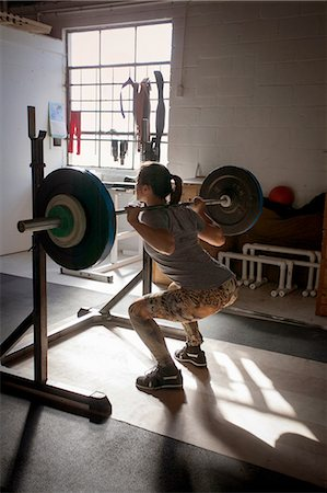 Crossfitter lifting barbell in gym Stock Photo - Premium Royalty-Free, Code: 614-08270413
