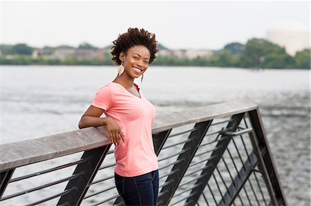 Young woman with afro hair Stock Photo - Premium Royalty-Free, Code: 614-08270432