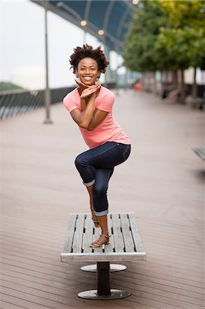 Young woman twisting and balancing on one leg Stock Photo - Premium Royalty-Free, Code: 614-08270433