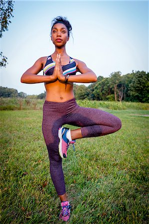 practise - Young woman doing a yoga tree pose in rural park Stock Photo - Premium Royalty-Free, Code: 614-08307734
