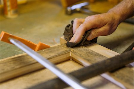 Wood artist working in workshop, close-up Stock Photo - Premium Royalty-Free, Code: 614-08307929