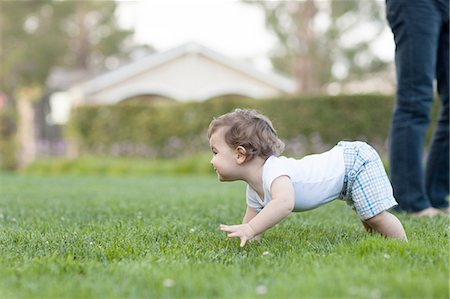 Side view of baby boy crawling on grass Stock Photo - Premium Royalty-Free, Code: 614-08307999