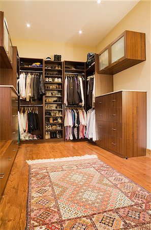 Walk-in closet with carpet in extension in luxurious cottage style log home, Quebec, Canada Stock Photo - Premium Royalty-Free, Code: 614-08329338