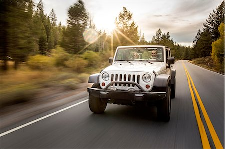 Young couple driving jeep on road trip, Lake Tahoe, Nevada, USA Stock Photo - Premium Royalty-Free, Code: 614-08329455