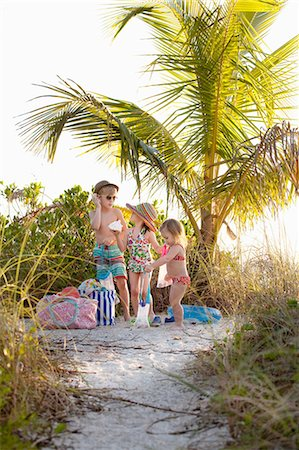 Boy and two sisters collecting seashells at beach, Sanibel, Florida, USA Stock Photo - Premium Royalty-Free, Code: 614-08383579