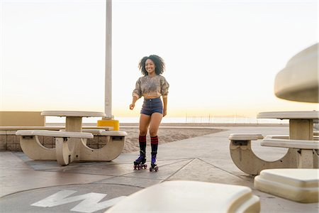 roller skate - Mid adult woman on rollerskates, near beach Stock Photo - Premium Royalty-Free, Code: 614-08392539