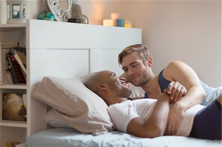 Male couple lying in bed together, face to face Stock Photo - Premium Royalty-Free, Code: 614-08392611