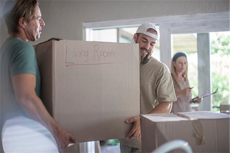 supervising - Moving house: two men carrying cardboard box Stock Photo - Premium Royalty-Free, Code: 614-08578483