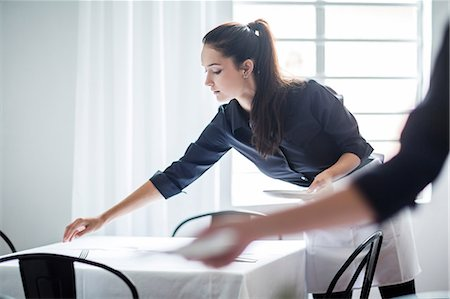 services - Waitresses setting table in restaurant Stock Photo - Premium Royalty-Free, Code: 614-08578559