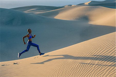 sprint - Runner sprinting in desert, Death Valley, California, USA Stock Photo - Premium Royalty-Free, Code: 614-08578676