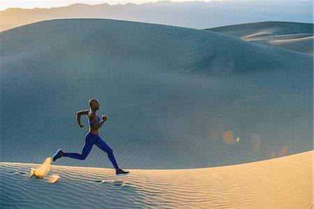 sprint - Runner sprinting in desert, Death Valley, California, USA Stock Photo - Premium Royalty-Free, Code: 614-08578677
