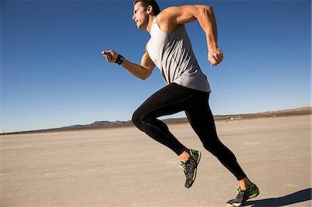sports - Man training, running on dry lake bed, El Mirage, California, USA Stock Photo - Premium Royalty-Free, Code: 614-08641807