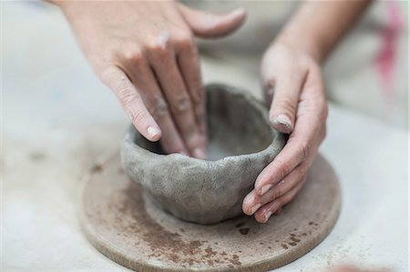 Hands of female potter shaping clay pot in workshop Stock Photo - Premium Royalty-Free, Code: 614-08684983