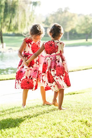 Two young girls dancing together on grass, rear view Stock Photo - Premium Royalty-Free, Code: 614-08685073