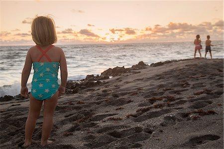 Girl looking out to sea at sunrise, Blowing Rocks Preserve, Jupiter Island, Florida, USA Stock Photo - Premium Royalty-Free, Code: 614-08685198
