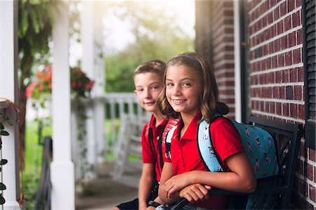 Portrait of twin brother and sister on first day of new school year Stock Photo - Premium Royalty-Free, Code: 614-08726630
