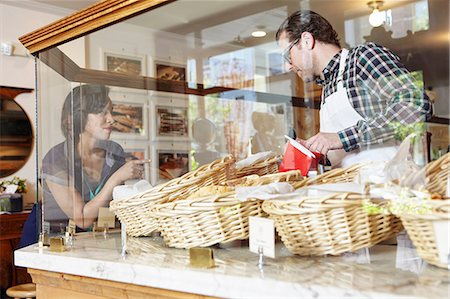 Customer in bakery pointing to baked goods Stock Photo - Premium Royalty-Free, Code: 614-08720533