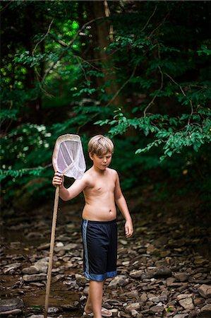 preteen boy shirtless - Boy with fishing net Stock Photo - Premium Royalty-Free, Code: 614-08874350