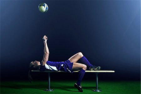 Female soccer player lying on bench Stock Photo - Premium Royalty-Free, Code: 614-08875692