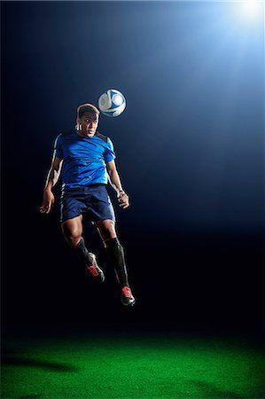 Male soccer player heading ball Stock Photo - Premium Royalty-Free, Code: 614-08875701