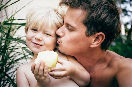 father son shirtless - Head and shoulders of father kissing son on cheek, Bludenz, Vorarlberg, Austria Stock Photo - Premium Royalty-Free, Code: 614-08879279
