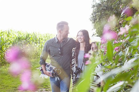 Romantic couple strolling in field Stock Photo - Premium Royalty-Free, Code: 614-08879478