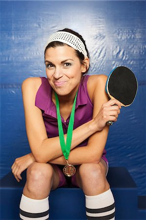 Table tennis medalist holding up bat Stock Photo - Premium Royalty-Free, Code: 614-08879604
