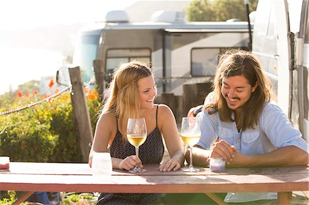 Couple having wine together outdoors Stock Photo - Premium Royalty-Free, Code: 614-08870715