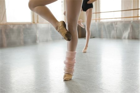 Two ballet dancers warming up Stock Photo - Premium Royalty-Free, Code: 614-08871884