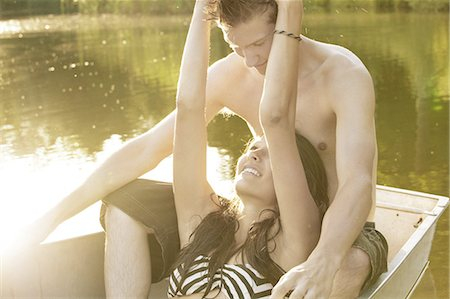 Teenage girl relaxing with man in boat Stock Photo - Premium Royalty-Free, Code: 614-08873060
