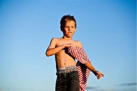 preteen boy shirtless - Boy playing with striped fabric Stock Photo - Premium Royalty-Free, Code: 614-08873704