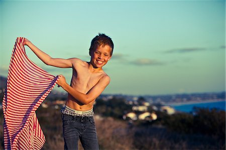 slim - Boy holding striped fabric Stock Photo - Premium Royalty-Free, Code: 614-08873701
