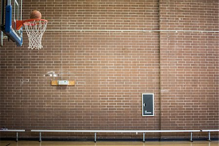 scoring - Basketball about to drop through basketball net Stock Photo - Premium Royalty-Free, Code: 614-08881114