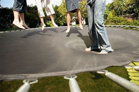 preteen girl feet - Children on trampoline Stock Photo - Premium Royalty-Free, Code: 614-00389922