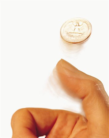 Hand tossing coin Stock Photo - Premium Royalty-Free, Code: 614-00397160