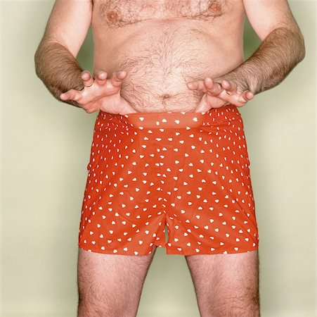 Male abdomen Stock Photo - Premium Royalty-Free, Code: 614-00393141