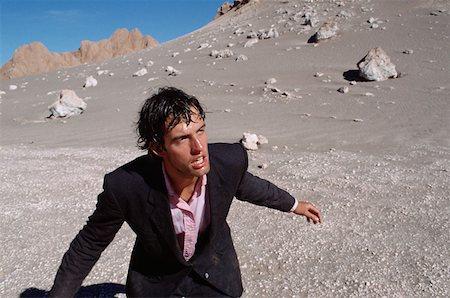 sweaty businessman - Businessman in desert Stock Photo - Premium Royalty-Free, Code: 614-00596412