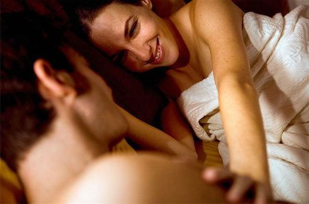 Couple hugging in bed Stock Photo - Premium Royalty-Free, Code: 614-00598460