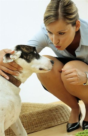 Dog with affectionate owner Stock Photo - Premium Royalty-Free, Code: 614-00599246