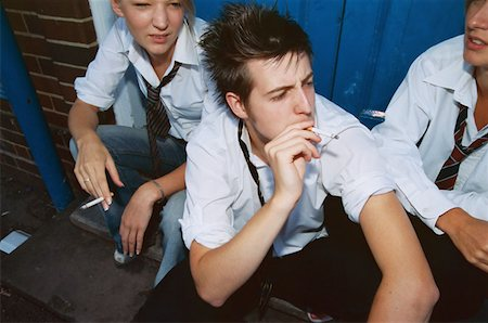 High school students smoking cigarettes Stock Photo - Premium Royalty-Free, Code: 614-00599912