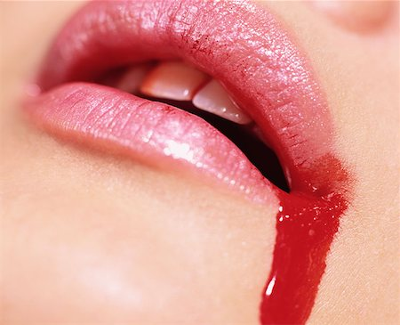 Blood spilling from woman's mouth Stock Photo - Premium Royalty-Free, Code: 614-00683988