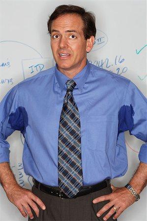 sweaty businessman - Businessman with sweaty underarms Stock Photo - Premium Royalty-Free, Code: 614-00844097